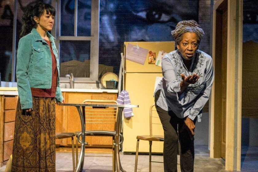 """Jyl Kaneshiro and Sylvia M'Lafi Thompson in Moxie Theatre's """"Brownsville song (b-side for tray)."""""""