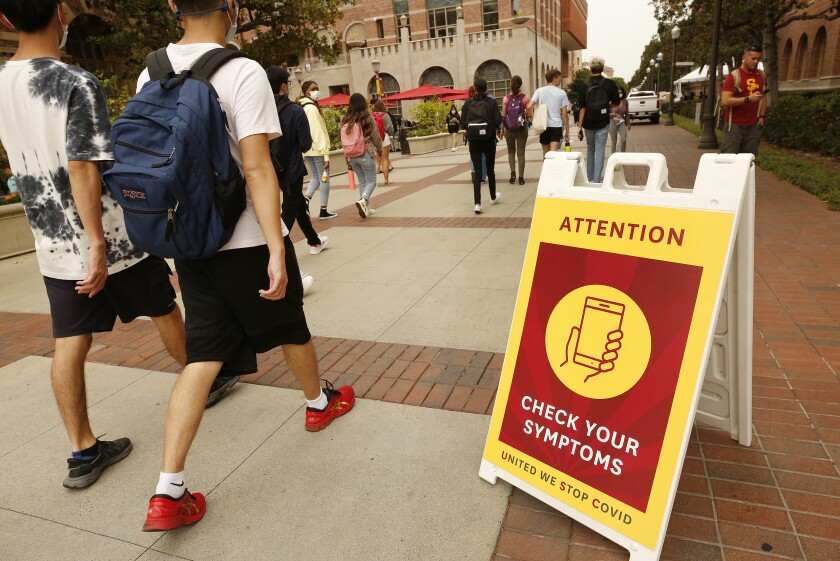 A sign on the USC campus Monday urges passersby to be vigilant about COVID-19.