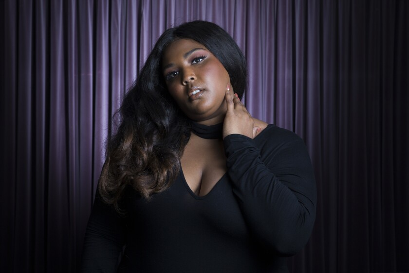 Lizzo scored eight Grammy nominations Wednesday, leading the field just ahead of Billie Eilish and Lil Nas X.