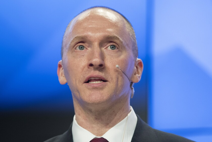 Carter Page, speaking here at a news conference at RIA Novosti news agency in Moscow, Russia, met with a retired American professor who was a secret informant for the FBI in July 2016.
