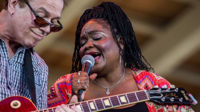 Shemekia Copeland, right, with guitarist Arthur Neilson at Blues on the Fox festival in Aurora, Ill.