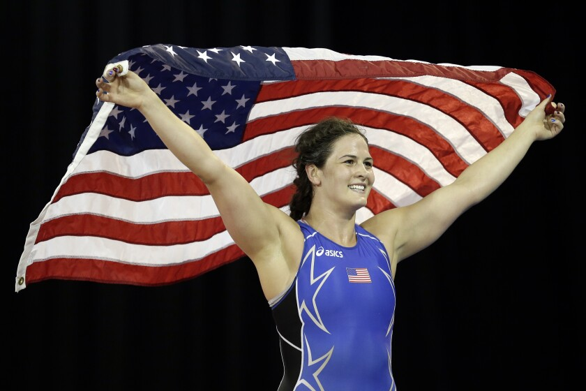 FILE - In this July 17, 2015, file photo, United States' Adeline Gray celebrates her gold medal win, defeating Canada's Justina Distasio during the women's freestyle 75 kg final in wrestling competition in the Pan Am Games in Mississauga, Ontario. Gray has done everything except win an Olympic gold medal during her outstanding career. The five-time world champion is one of the most dominant competitors ever in women's freestyle wrestling. But misfortune struck at the 2016 Games when she lost to Vasilisa Marzaliuk of Belarus in the quarterfinals. (AP Photo/Gregory Bull, File)