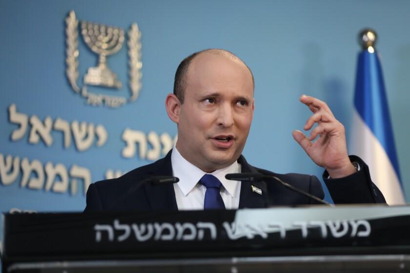 Israeli Prime Minister Naftali Bennett speaks during a news conference