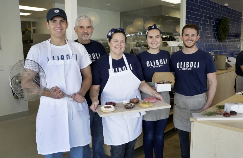 From left, Hunter, Victor, Brooke, Hailey and Jon DesPrez with a selection of doughnuts at their family-owned storem Oliboli Donuts in Old Town Tustin, which opened Oct. 22. Oliboli's uses coconut oil. The handmade dough rises over a 40-hour period.