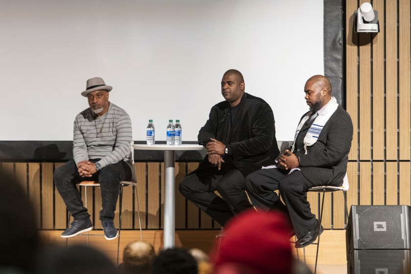 "William Moore, left, Anthony Wilson, center, and Jeffrey Wilson, right, speak at a conversation and private screening of ""Both Sides of the Gun,"" at Malcolm X College, Thursday, Feb. 13, 2020, in Chicago. (Tyler LaRiviere/Chicago Sun-Times via AP)"