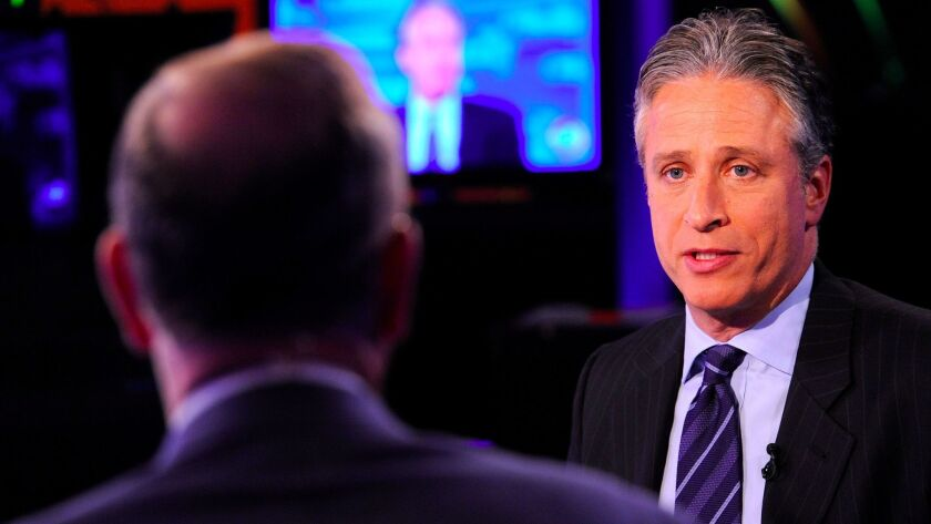 Fox's Bill O'Reilly, left, and Comedy Central's Jon Stewart on Sept. 22, 2010.