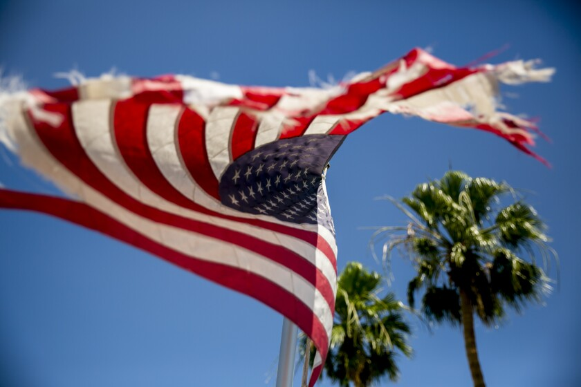 An American flag waves down the street from the El Centro Regional Medical Center