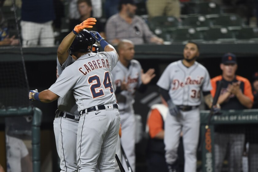 Detroit Tigers' Miguel Cabrera is hugged by Jeimer Candelario after hitting his 499th career home run in a baseball game against the Baltimore Orioles, Wednesday, Aug. 11, 2021, in Baltimore. (AP Photo/Gail Burton)