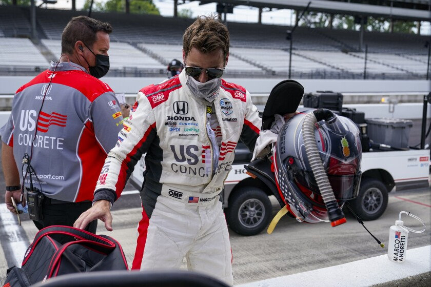 Marco Andretti packs up his gear following practice for the Indianapolis 500 auto race at Indianapolis Motor Speedway in Indianapolis, Thursday, Aug. 13, 2020. (AP Photo/Michael Conroy)
