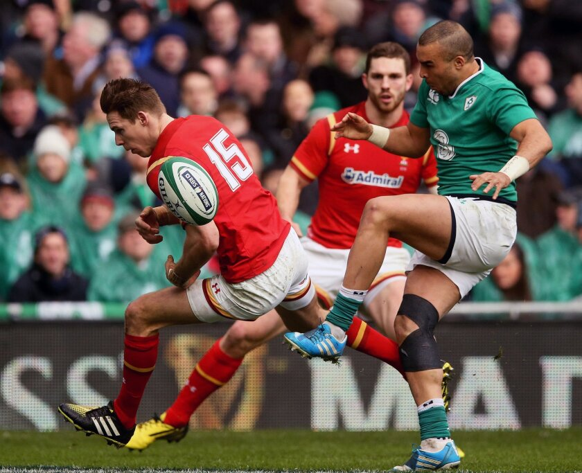Wales' Liam Williams, left, fails to gather a cross field kick whilst under pressure from Ireland's Simon Zebo, right, during their 2016 Six Nations rugby match at the Aviva Stadium in Dublin, Ireland, Sunday Feb. 7, 2016. (Brian Lawless / PA via AP) UNITED KINGDOM OUT - NO SALES - NO ARCHIVES