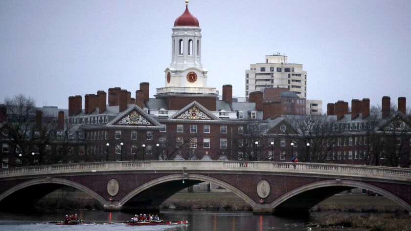 FILE - In this March 7, 2017, file photo, rowers paddle down the Charles River past the campus of Ha
