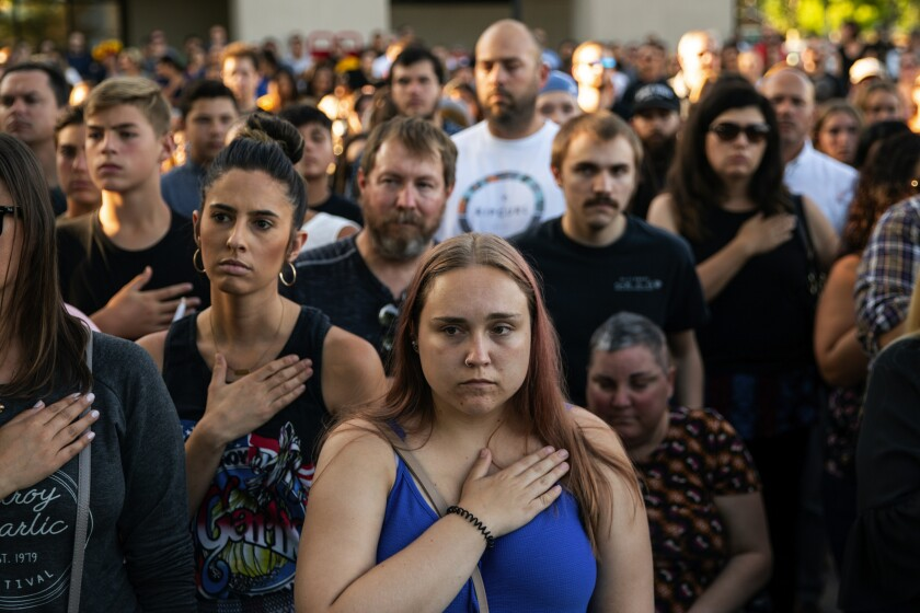 Residents attend a vigil for three people who were killed in a shooting at the Gilroy Garlic Festival in Northern California in July.