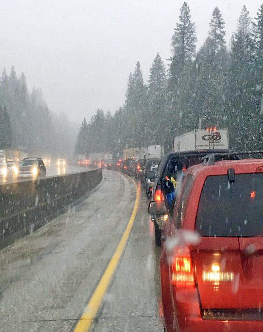 This photo provided by KTXL-TV shows traffic at a standstill on Interstate 80 at Drum Forebay near the town of Alta in the Sierra Nevada of Northern California. A late spring storm with snow at higher elevations and heavy rain elsewhere caused a rash of accidents and off-and-on closures of the main road between Sacramento and Reno, Nev. (KTXL-TV via AP) TV OUT MANDATORY CREDIT