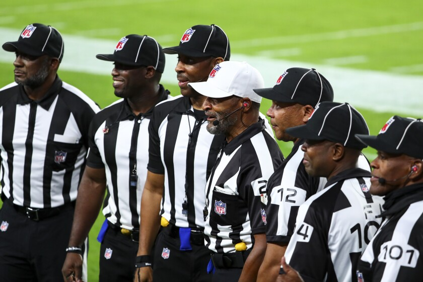 NFL officials pose for a photo before Monday's game between the Rams and Buccaneers.