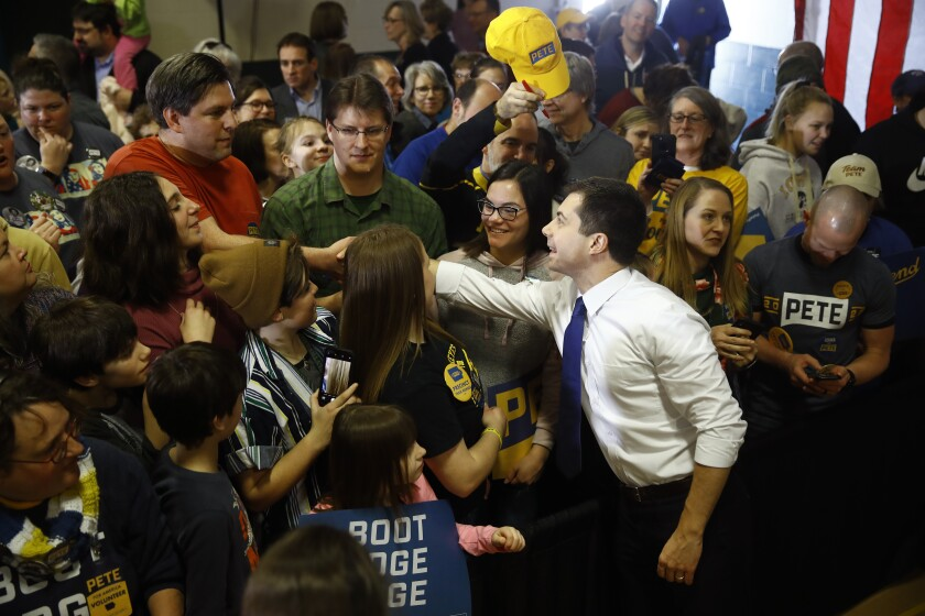Democratic presidential candidate Pete Buttigieg meets Iowans during a campaign event Sunday at Northwest Junior High in Coralville.