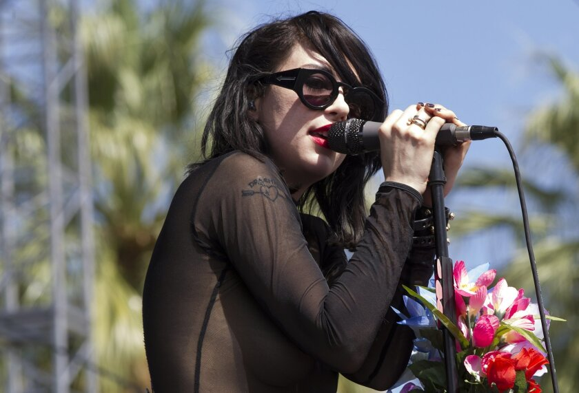 On the first day of the Coachella Valley Music and Arts Festival a sold out crowd got the party started. Former San Diegan Kristen Gundred who goes by Dee Dee Penny as she sings for the band the Dum Dum Girls on the Outdoor Stage Friday afternoon.