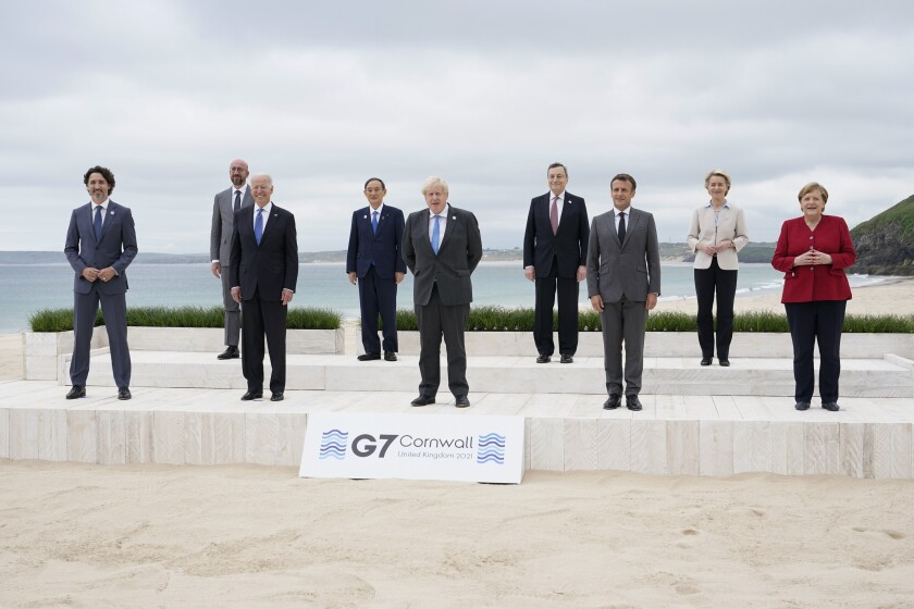 Leaders of the Group of 7 pose for a photo at the beach in Cornwall, England, on June 11, 2021.