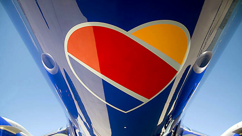 Southwest Airlines moves toward completing the merge with AirTran Airways by blending websites and f