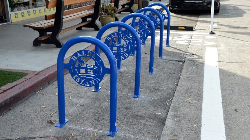 Sapphire blue bike corrals, with bridge, tree and water are now part of Marine Avenue streetscape.
