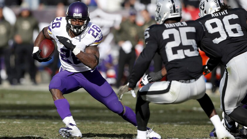 Adrian Peterson (28) and the Vikings will play the Packers on Sunday with the winner taking the NFC North title.