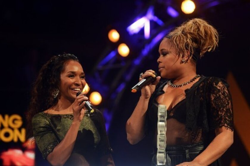 """Rozonda """"Chilli¿ Thomas"""" left, and Tionne """"T-Boz"""" Watkins of TLC accept the award for Outstanding Contribution to Music at the 2012 MOBO awards in Liverpool, England."""