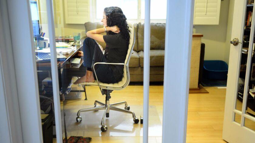 Laila Lalami writing at home.