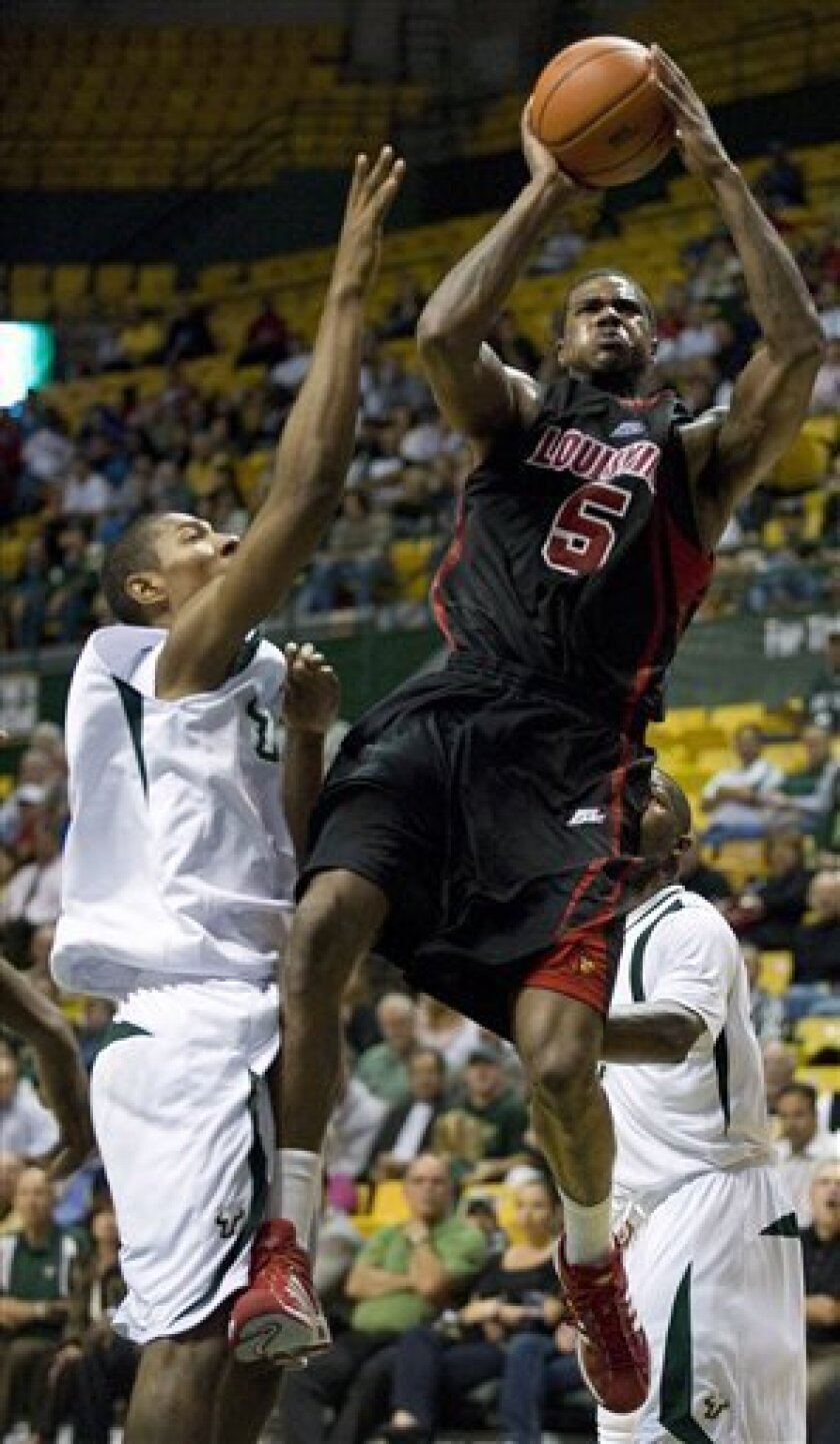 Louisville forward Earl Clark (5) shoots past  South Florida forward Eladio Espinosa, left, during the first half of an NCAA college basketball game Wednesday, Jan. 7, 2009 in Tampa, Fla. (AP Photo/Steve Nesius)