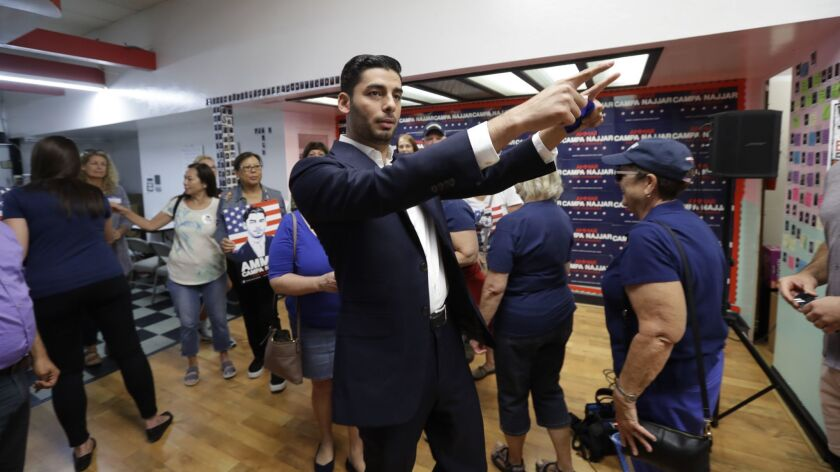 Democratic congressional candidate Ammar Campa-Najjar, center, motions with supporters before canvasing Monday, Nov. 5, 2018, in Escondido, Calif. Campa-Najjar lost to indicted U.S. Rep. Duncan Hunter in the race for Southern California's 50th district.