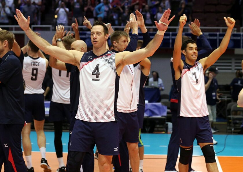 David Lee (4), Kawika Shoji (7) and the rest of U.S. men's volleyball team celebrate their win over Russia in an FIVB World League match at Kay Bailey Hutchison Convention Center in Dallas on Sunday, July 3, 2016. (Richard W. Rodriguez/Fort Worth Star-Telegram/TNS) ** OUTS - ELSENT, FPG, TCN - OUTS