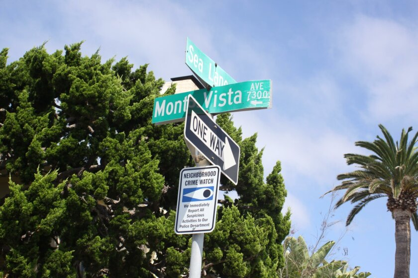Signs in the Barber Tract area of La Jolla indicate suspicious activity would be reported to police.