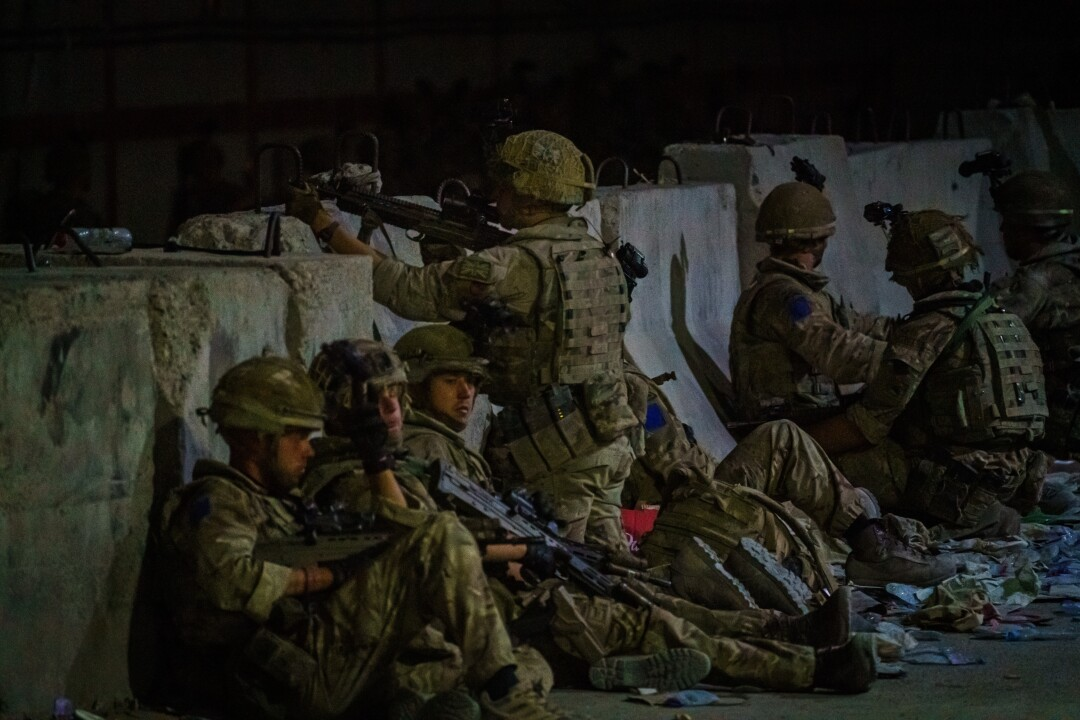 British soldiers secure the perimeter outside the Baron Hotel, near the Abbey Gate, in Kabul, Afghanistan