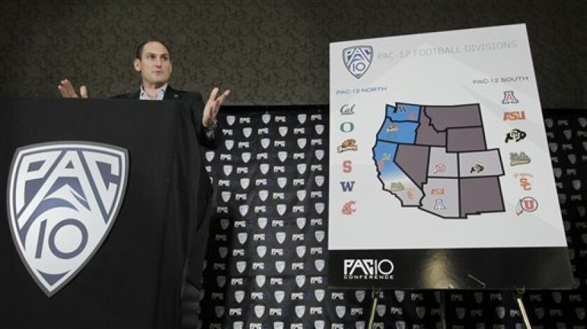 Pac-10 commissioner Larry Scott announces the splitting of NCAA college football divisions during a news conference in San Francisco, Thursday, Oct. 21, 2010. Colorado and Utah recently accepted invitations to join the Pac-10 in the conference's first expansion since 1978, necessitating many change