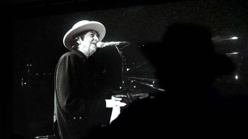 Bob Dylan performs on the big screen at the Empire Polo Club grounds in Indio, Calif., on Oct. 7.