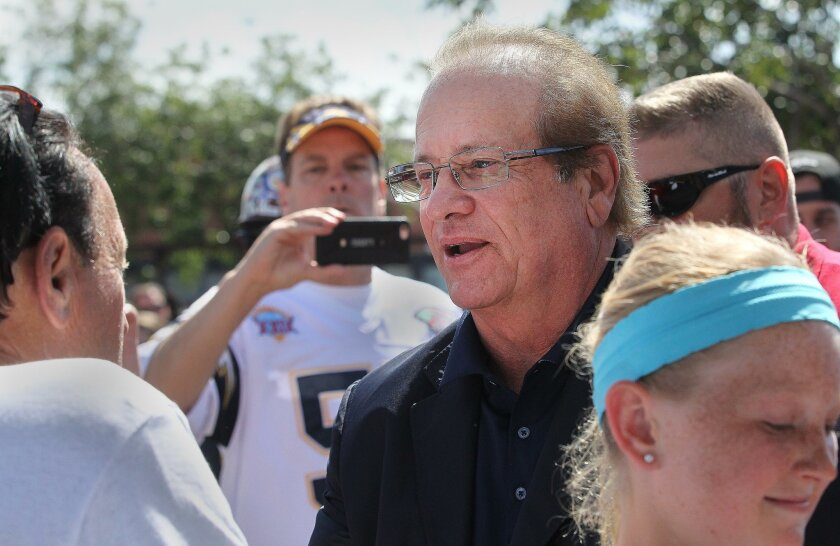San Diego Chargers Chairman Dean Spanos meets with fans at the Chargers Citizen Initiative rally held in a parking lot Saturday east of Petco Park.