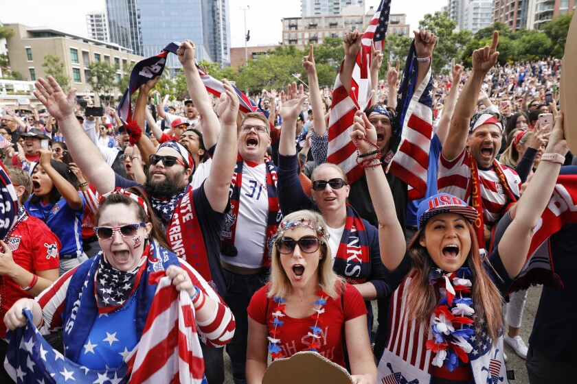 Several thousand soccer fans celebrate during a 2019 FIFA Women's World Cup Final Watch Party at Petco's Park at the Park on Sunday morning as the women's team won its fourth World Cup title in France. Pictured, left to right in the front row, are Lauryn Smith, Michelle Pekos and Aileen Burns.