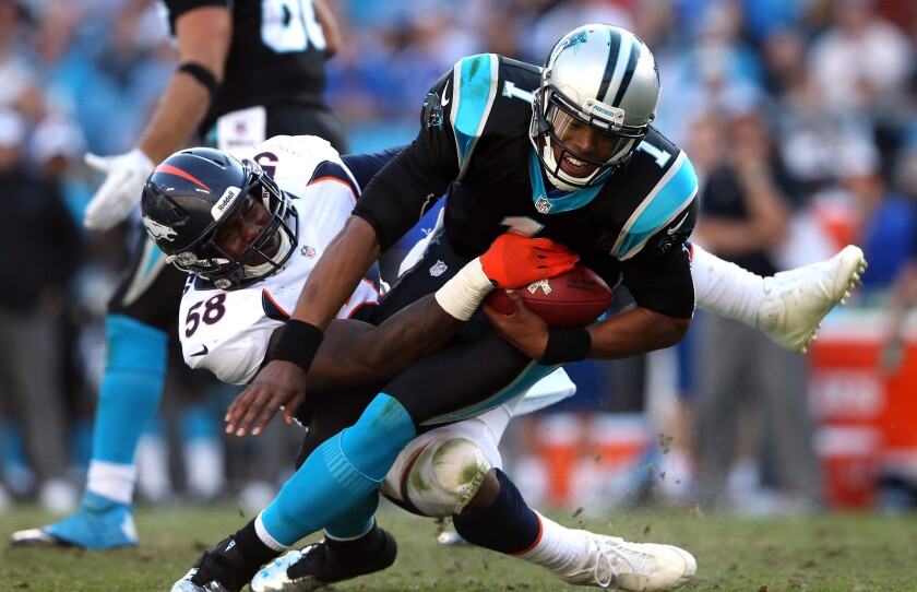 Broncos linebacker sacks Panthers quarterback Cam Newton during their game Sunday in Charlotte, N.C.