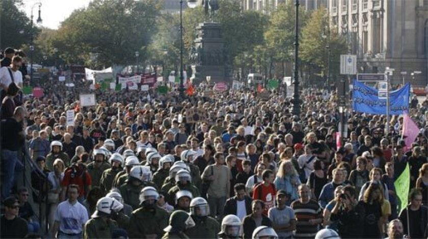 """German riot police escort about 8,000 demonstrators in central Berlin in September as they protest against a """"surveillance state"""" and planned laws to collect personal and private data."""