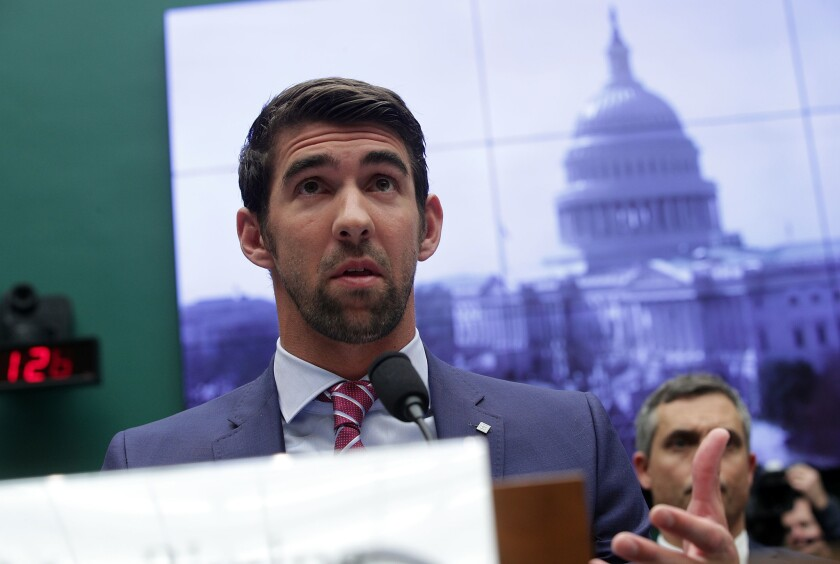 Swimmer Michael Phelps speaks during a congressional hearing Tuesday on Capitol Hill.