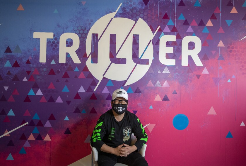 Triller CEO Mike Lu sits for a portrait at Triller's office in Century City.