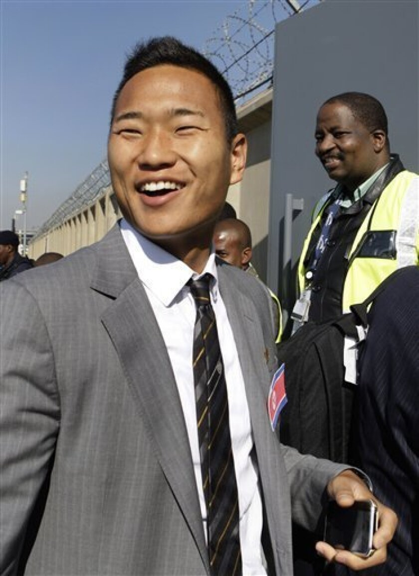"""FILE - The June 11, 2010 file photo shows North Korea soccer player Jong Tae Se on arrival at the OR Tambo International Airport in Johannesburg. He plays like Rooney but behaves like Beckham. He loves his cars, his rap music and his clothes, and changes hairstyles more quickly than you can say """"Ki"""