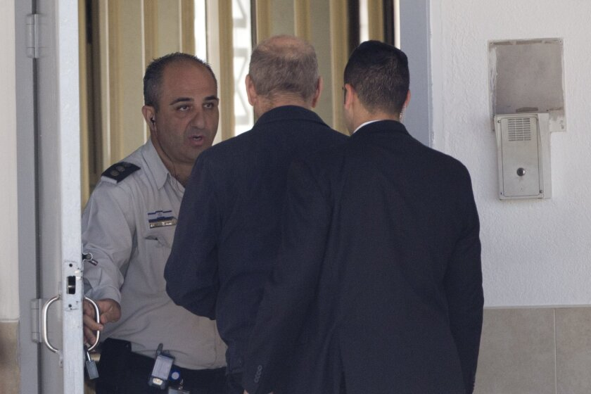 Former Israeli Prime Minister Ehud Olmert enters prison to begin his sentence, in the central Israeli town of Ramle, Israel, Monday, Feb. 15, 2016. Israel's former Prime Minister Ehud Olmert started serving a 19-month prison sentence for bribery and obstruction of justice on Monday, becoming the fi