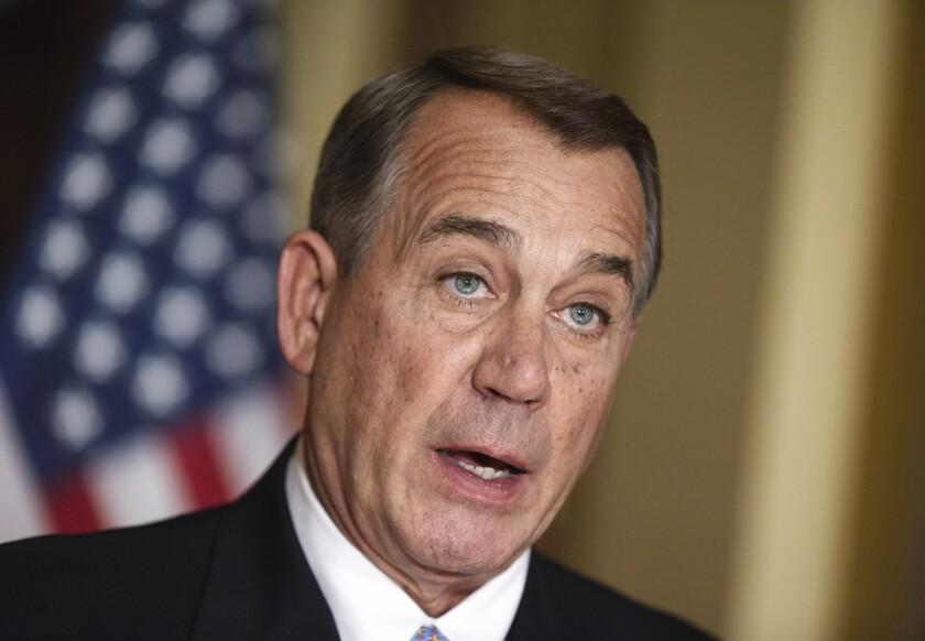 House Speaker John Boehner of Ohio speaks to reporters in Washington on Friday.