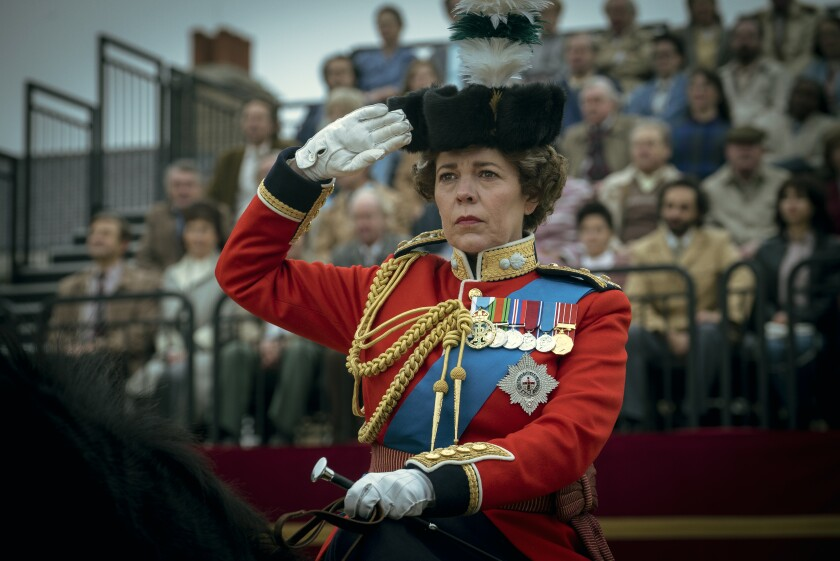 """This image released by Netflix shows Olivia Colman as Queen Elizabeth II in a scene from """"The Crown."""" The show was nominated for a Golden Globe for best drama series on Wednesday, Feb. 3, 2021. (Liam Daniel/Netflix via AP)"""