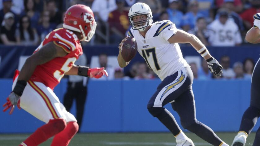 LOS ANGELES, CA, SUNDAY, SEPTEMBER 24, 2017 -- Chargers quarterback Philip Rivers avoids pressure as