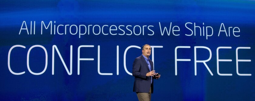 Intel CEO Brian Krzanich talks about materials used to make Intel microprocessors during a keynote address at the International Consumer Electronics Show, Monday, Jan. 6, 2014, in Las Vegas. (AP Photo/Julie Jacobson)