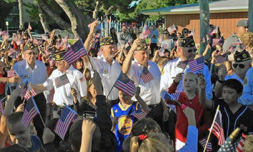 Harbour View Elementary School in Huntington Beach invited more than 20 veterans to classrooms Monday so students could ask them questions about their military service.