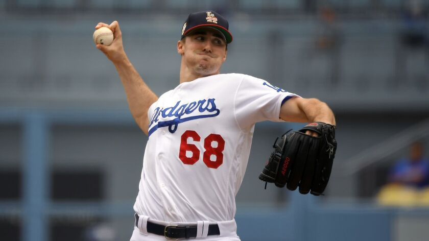 Ross Stripling delivers during the first inning of the Dodgers' 5-3 loss to the San Diego Padres on Sunday.