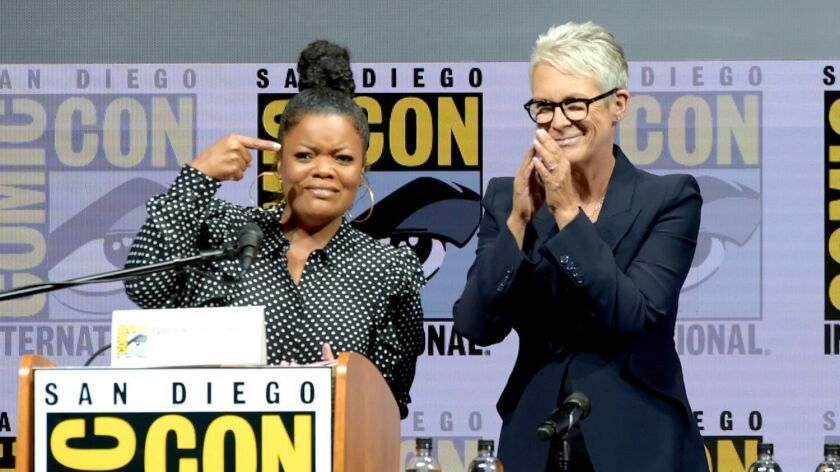 """Yvette Nicole Brown, left, and Jamie Lee Curtis onstage at Universal Pictures' """"Halloween"""" panel during Comic-Con International 2018."""