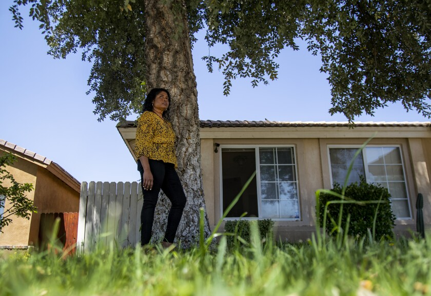 Arane Pineda was furloughed from her job as an assistant teacher, and her husband has lost hours as a truck driver.