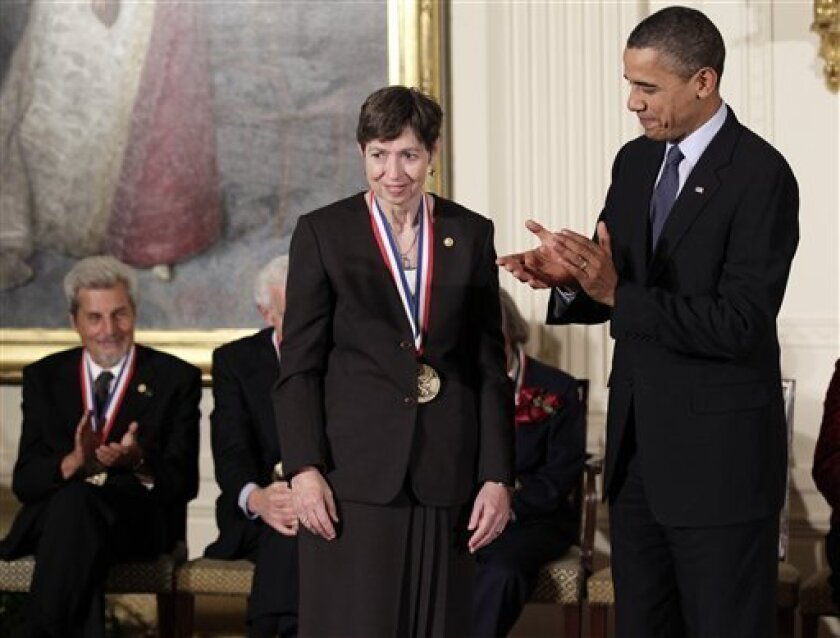 President Barack Obama stands with Marye Anne Fox, a renowned organic chemist and chancellor at the University of California, San Diego, at a ceremony for recipients of the National Medal of Science and the National Medal of Technology and Innovation, the highest honors bestowed by the United State